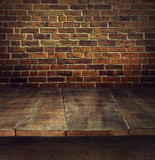 Fototapety Old wooden table with brick background