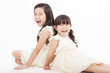 happy girls sitting on the white background