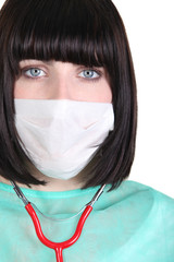 Woman in scrubs and medical mask