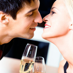 Couple kissing at restaurant