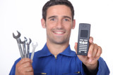 Mechanic showing mobile phone