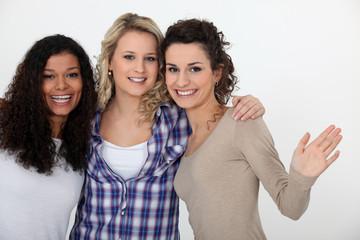 three happy girlfriends