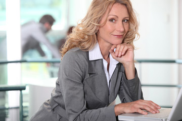 Confident executive with a laptop