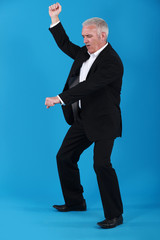 mature businessman dancing