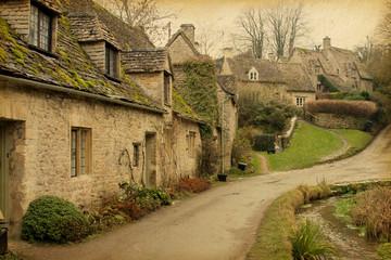 Bibury.  England, UK. Photo in retro style. Paper texture.