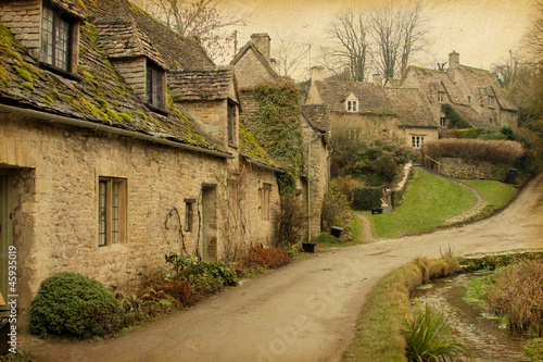 Bibury.  England, UK. Photo in retro style. Paper texture.