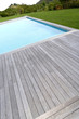 Closeup of private pool and wood deck