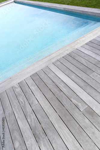 Closeup of private pool and wood deck - 45935495