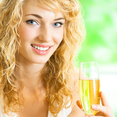 Young woman with glass of champagne