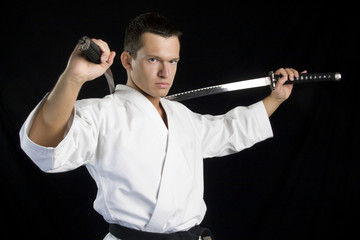 Karate man with katanas