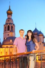 husband wife hug near Alexander Nevsky church in Vologda