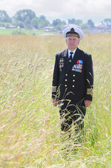Grandfather in form, ordens, medals stand attention in field