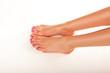 Female feet with nail varnish