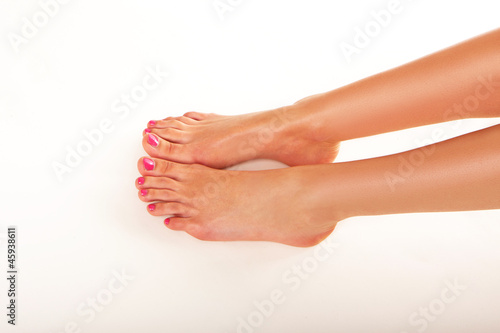 Female feet with nail varnish