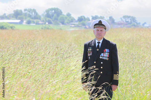 Grandfather in form, ordens, medals pose in field