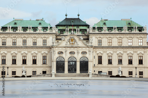 Pigeons near Belvedere castle with statue in Vienna, Austria