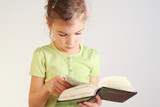 Little girl read bible