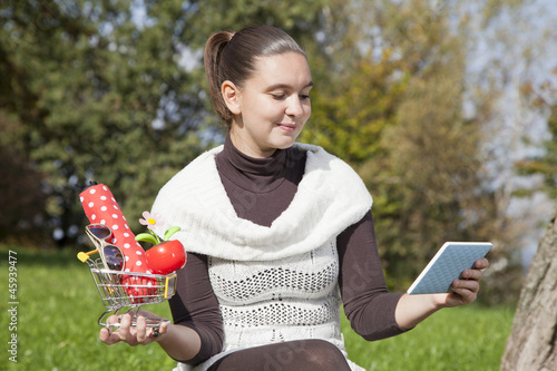 Cute girl thinks about online shop-concept