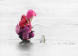 Little child fishing on a frozen lake in winter. - 45939858