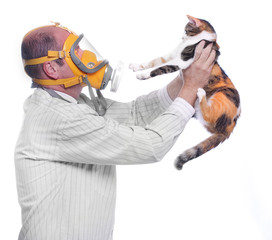 Allergy to animal fur concept. Man in respirator and his cat.