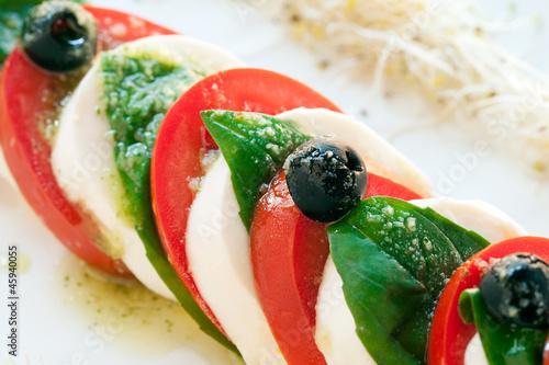 Detail of mozzarella and tomato salad.