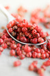 Pink peppercorns in a spoon