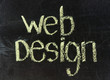 Conceptual hand drawn WEB DESIGN on black chalkboard.