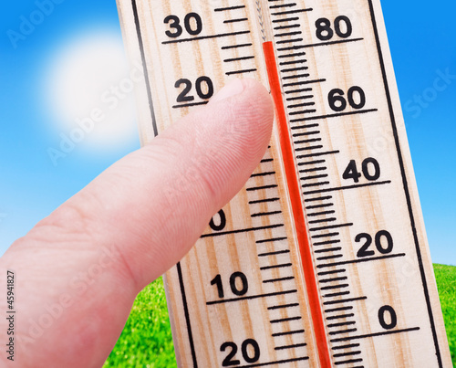 Thermometer in hand, shows a strong heat