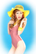 Bright seductive charming pin-up girl in a pink bathing suit.