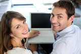 Upper view of smiling couple using laptop computer
