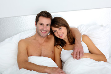 Portrait of lovers embracing each other in bed