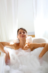 Beautiful woman relaxing in bathtub