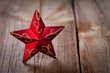 red star on weathered wooden board