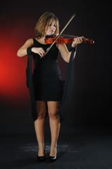Beautiful musician playing violin
