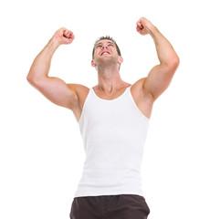 Happy male athlete rejoicing success