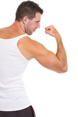 Athletic man showing strong biceps