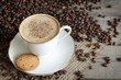 Cappuccino and coffee beans vintage still life on wooden boards