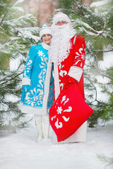 Russian Christmas: Ded Moroz and Snegurochka with gifts bag
