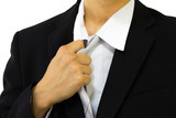 businessman untying his tie I