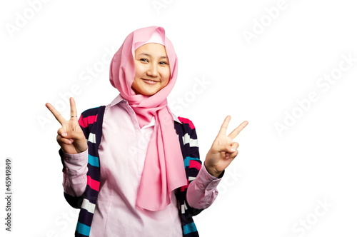 Beautiful young muslim woman isolated on black background