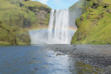 Skogafoss with a rainbow at Iceland poster