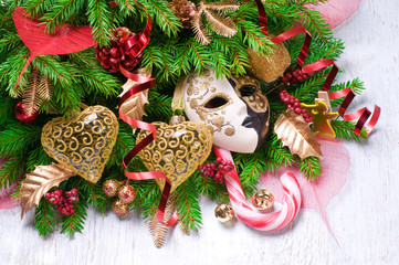 The christmas background with candy and mask