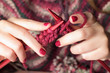 Leinwandbild Motiv Close-up of hands knitting
