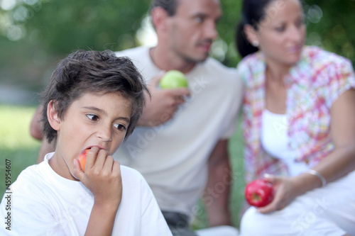 Father and son eating apples