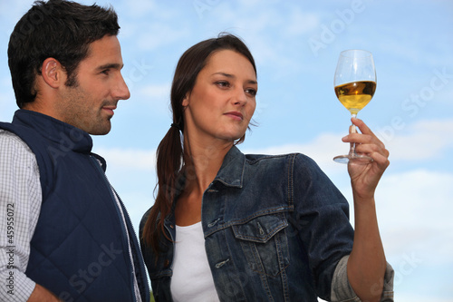Woman with drink next to man