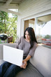 Woman using her laptop on her veranda