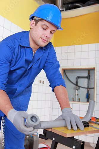 Plumber installing water pipes