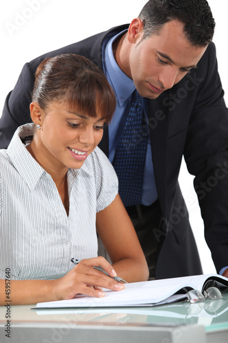 Office workers at a desk