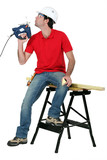Man blowing on band-saw to cool it down