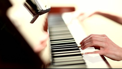 Close-up of pianist's hands playing